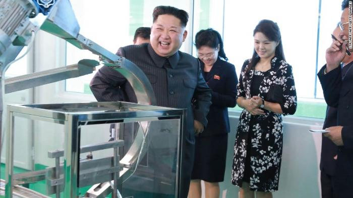 Kim Jong-un with Ri Sol-ju in North Korea cosmetics factory