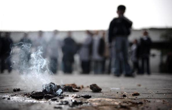 A picture taken on January 24, 2009 shows a piece of alleged white phosphorous still burning at UN Relief and Works Agency's primary school in Beit Lahia in the northern Gaza Strip. Photo credit: Olivier Laban-Mattei (AFP/Getty Images)