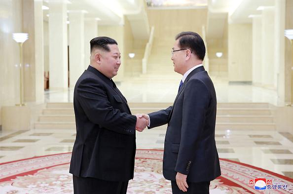 Chung Eui-Yong (R), head of South Korea's presidential National Security Office, shakes hands with North Korean leader Kim Jong-Un (L) during their meeting on March 5, 2018 in Pyongyang, North Korea.