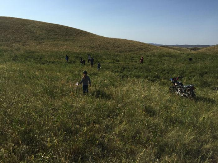 Men, women, and children collect wild strawberries on the Semipalatinsk test site. Photo copyright Magdalena Stawkowski.