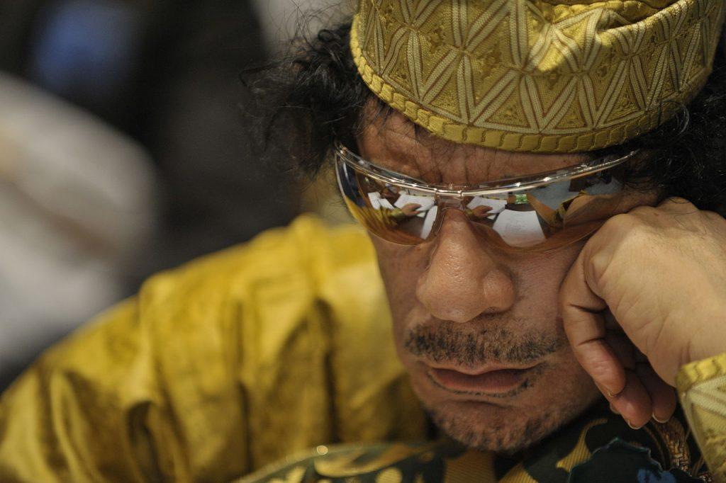 1280px-Muammar_al-Gaddafi,_12th_AU_Summit,_090202-N-0506A-324.jpg