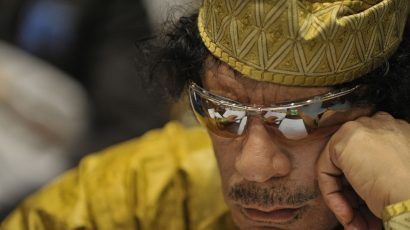 1280px-Muammar_al-Gaddafi,_12th_AU_Summit,_090202-N-0506A-324.jpg