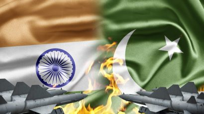 India and Pakistan flags with missiles and fire (Shutterstock)