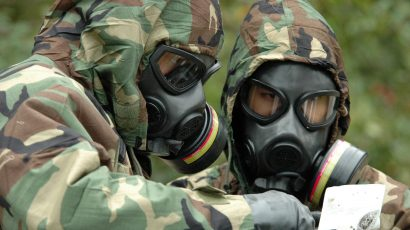 US service members conduct a chemical warfare exercise.