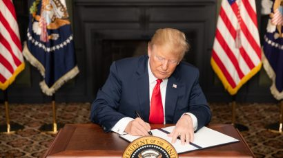 President Trump signs an Executive Order on Iran sanctions on August 5, 2018.