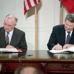 President Ronald Reagan and Soviet General Secretary Gorbachev signing the INF Treaty in the East Room of the White House on December 8, 1987.