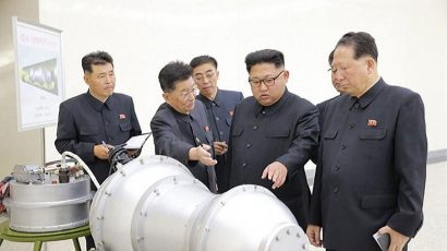 Scientists briefing North Korean leader Kim Jong-un in a photo released in 2017 Credit: Korean Central News Agency.