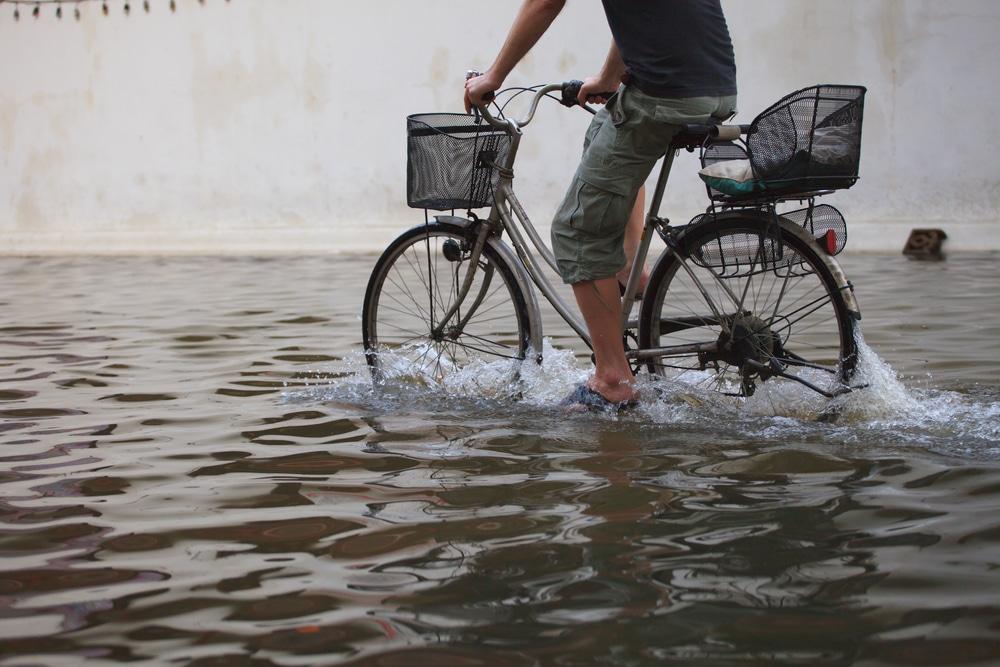 biking through floodwaters