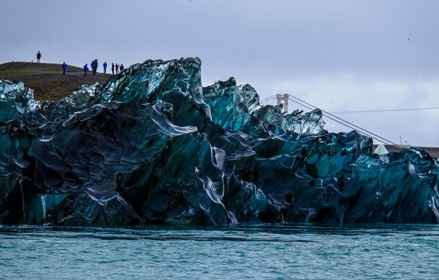 Glassy ice floe with watchers on-shore