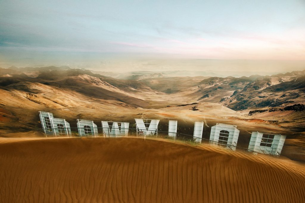 Hollywood sign submerged in sand