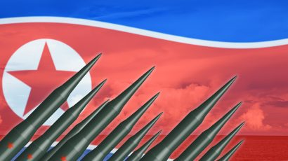 missiles and N Korea flag