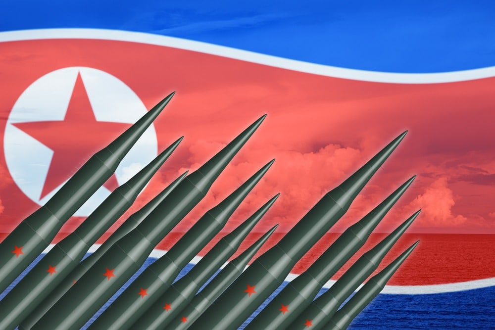 missiles and N Korea flag