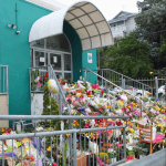 Flowers outside a mosque in New Zealand to commemorate the victims of an attack on two mosques that killed 50 people. Credit: Mike Dickison via Wikimedia Commons. CC BY 4.0. (Edited)