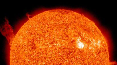 plasma swirls on orange sun