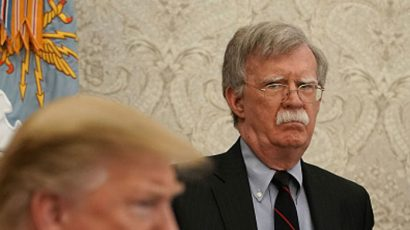 National Security Adviser John Bolton standing behind President Trump in April. Photo credit: Getty Images