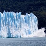 glacier ice falling into sea