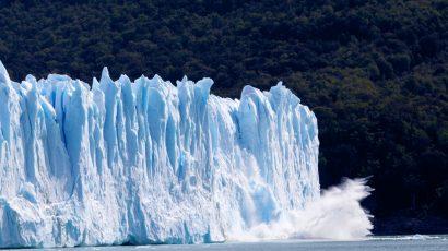 glacier ice falling into sea