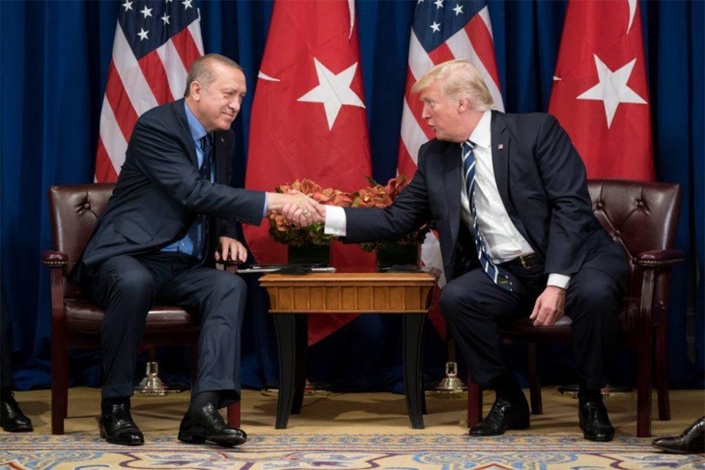 Erdogan and Trump shake hands