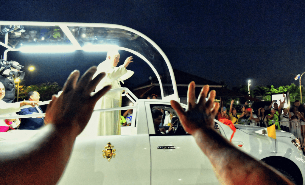 Pope Francis waves to a crowd.
