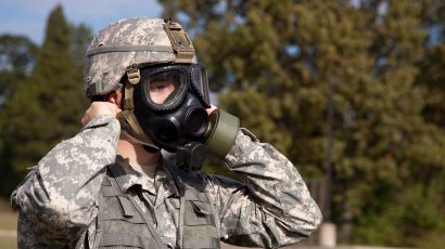 Soldier donning a gas mask.