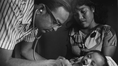 Doctor examining Marshallese infant