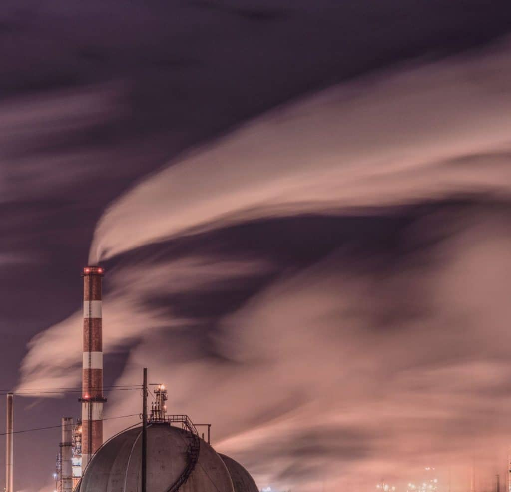 smokestack and gas plant emissions, surreal sky