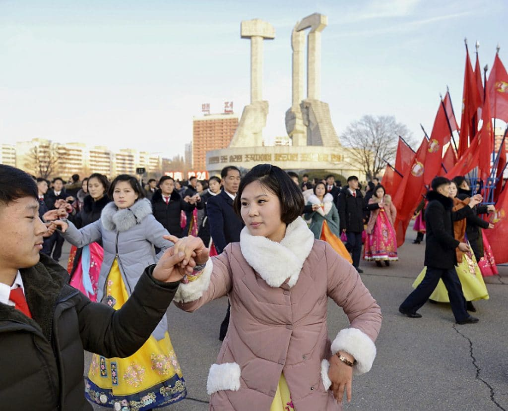 People dance in Pyongyang on Dec. 24, 2019, the birthday of North Korean leader Kim Jong Un's late grandmother, Kim Jong Suk. (Photo by Kyodo News via Getty Images)