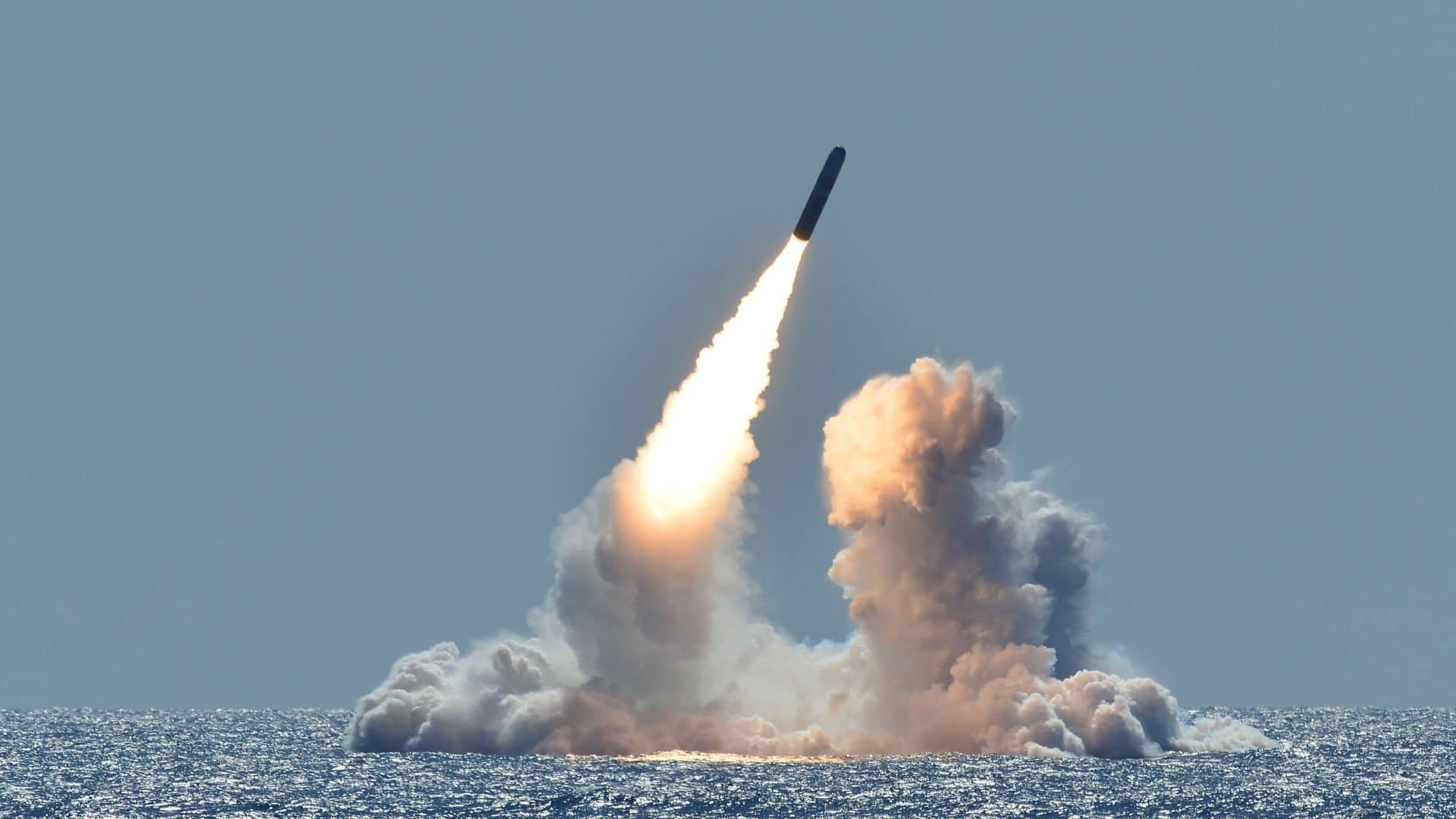 The US military tests a missile in the ocean.