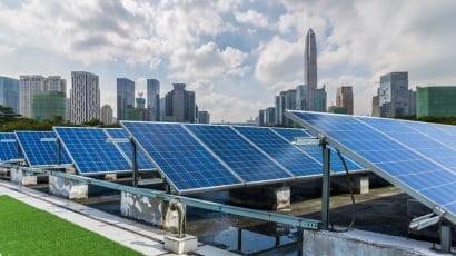 solar panels and city skyline