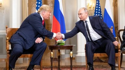 US President Donald Trump and Russian President Vladimir Putin shaking hands in 2018. Photo credit: White House.