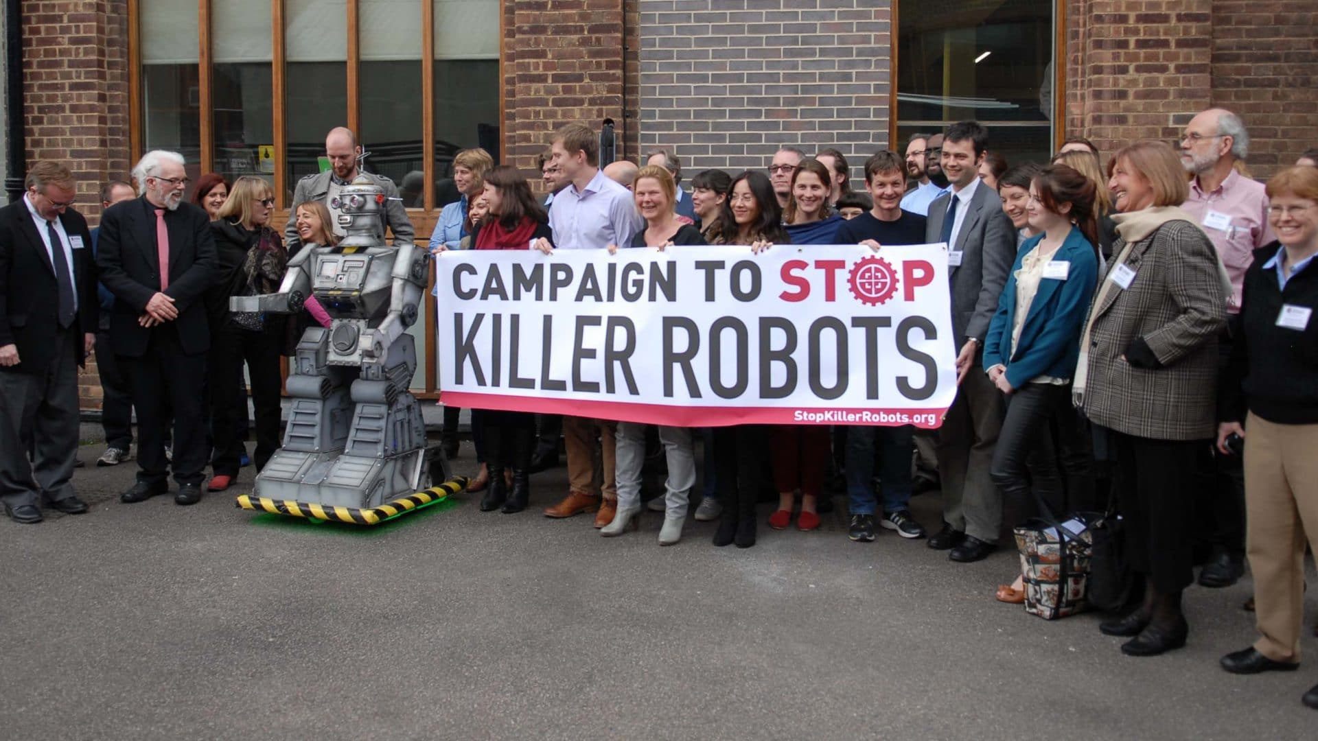 Activists hold a banner for the Campaign to Stop Killer Robots.