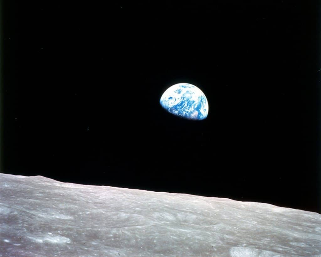 Earth rising above the moon