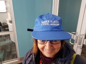 woman with Make Earth Cool Again hat