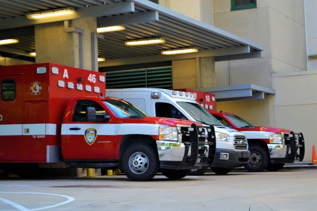 Ambulances wait outside an emergency room.