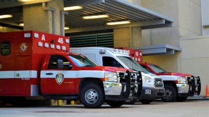 Ambulances wait outside an emergency room.