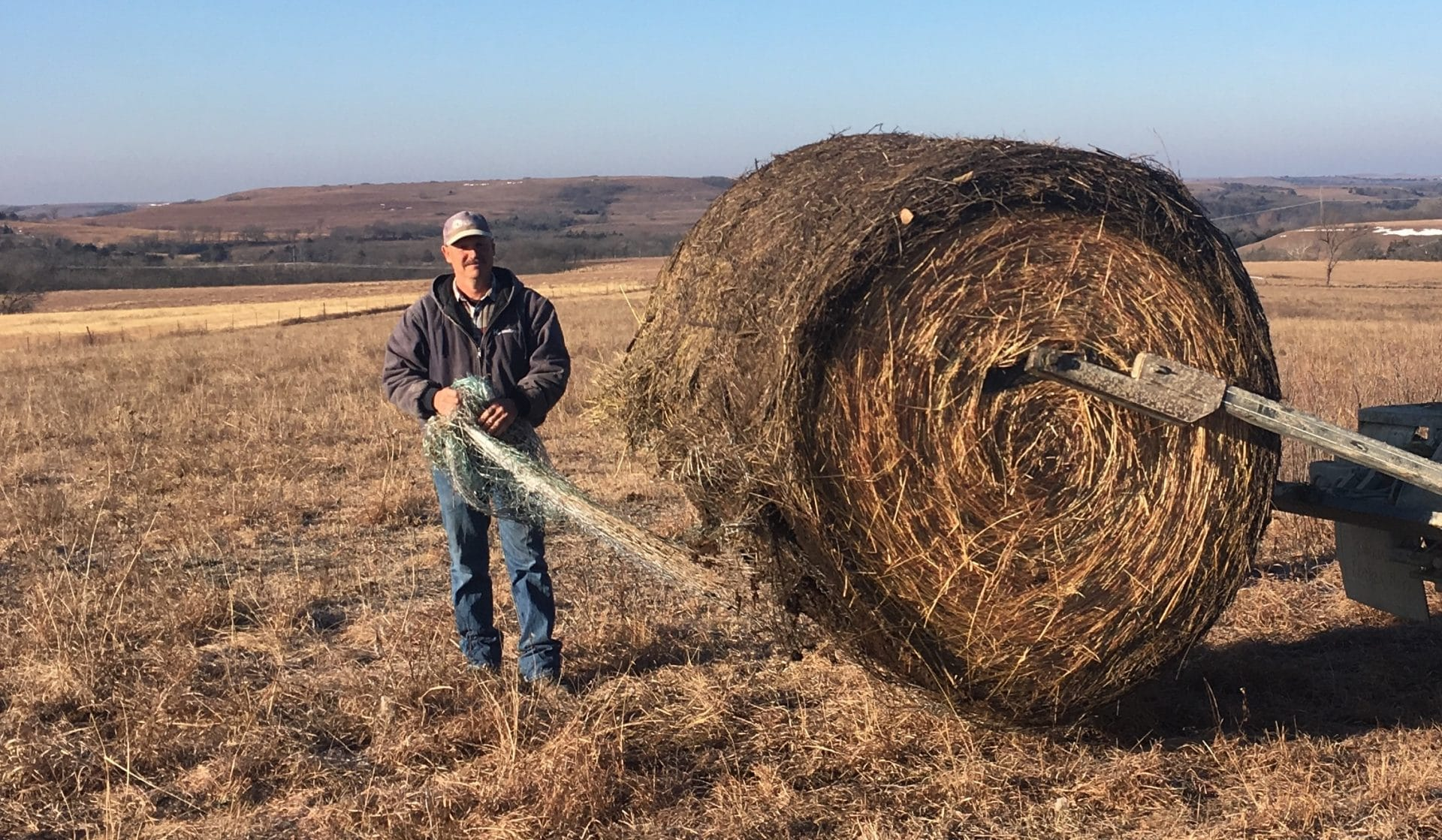 Matt Anderson prepares to feed cattle on his ranch in Alma, Kansas. Photo by Elisabeth Eaves
