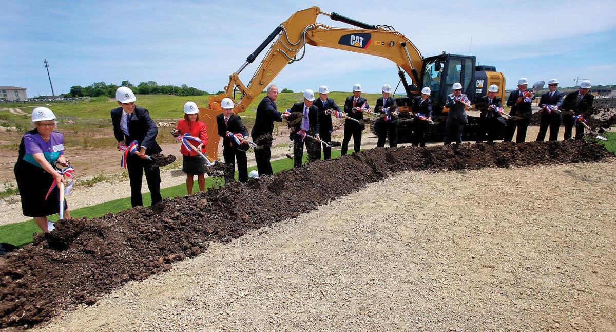 Sen. Pat Roberts (center) with state, federal, and Kansas State University officials for the NBAF groundbreaking in 2015. Photo office of Sen. Pat Roberts