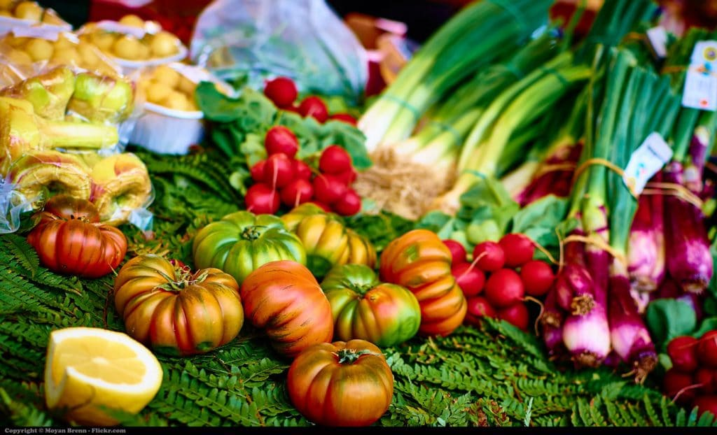 A greengrocer's table, full of vegetables.