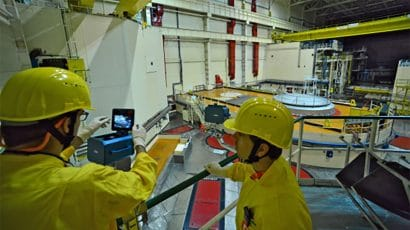 IAEA nuclear safeguards inspectors with remote surveillance equipment