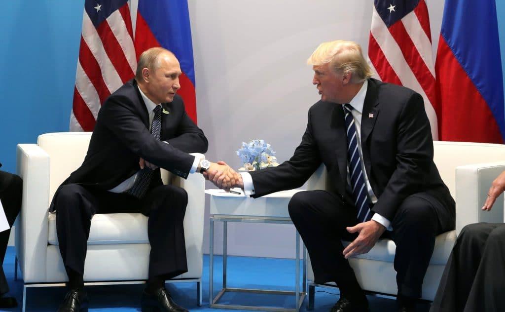 Vladimir Putin and Donald Trump at a 2017 G20 meeting in Hamburg.