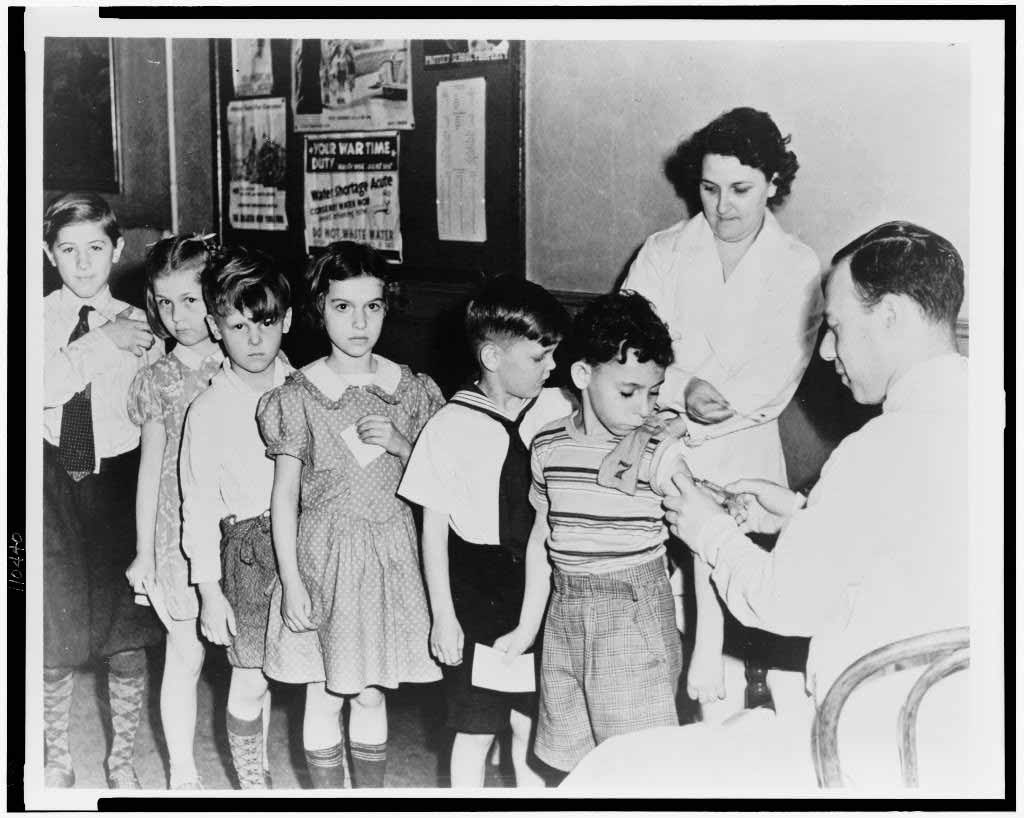 Children getting immunized at a health station in New York City.