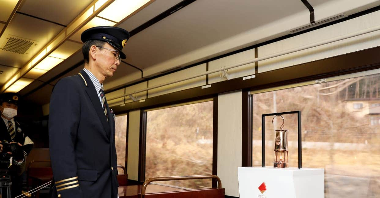 Olympic Torch Relay Lantern on its way to Fukushima aboard a train
