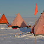 "Known as pyramid tents or Scott tents, they're essentially the same tent design used by the original polar explorers a hundred years ago, capable of withstanding winds of up to 70 miles per hour. ""They're just so good, they got the design perfect,"" says the author. Image courtesy of Peter Davis."