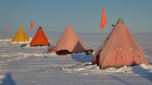 """Known as pyramid tents or Scott tents, they're essentially the same tent design used by the original polar explorers a hundred years ago, capable of withstanding winds of up to 70 miles per hour. """"They're just so good, they got the design perfect,"""" says the author. Image courtesy of Peter Davis."""