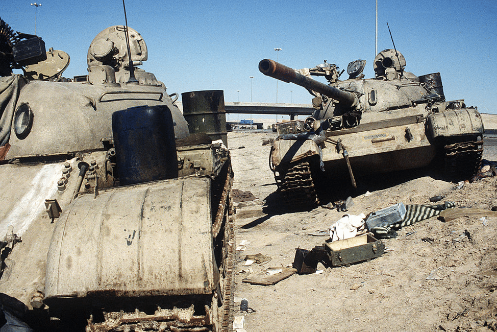 Two Iraqi T-54/55 tanks lie abandoned near Kuwait City on February 26, 1991. (Photo courtesy of PHC HOLMES, US Navy)