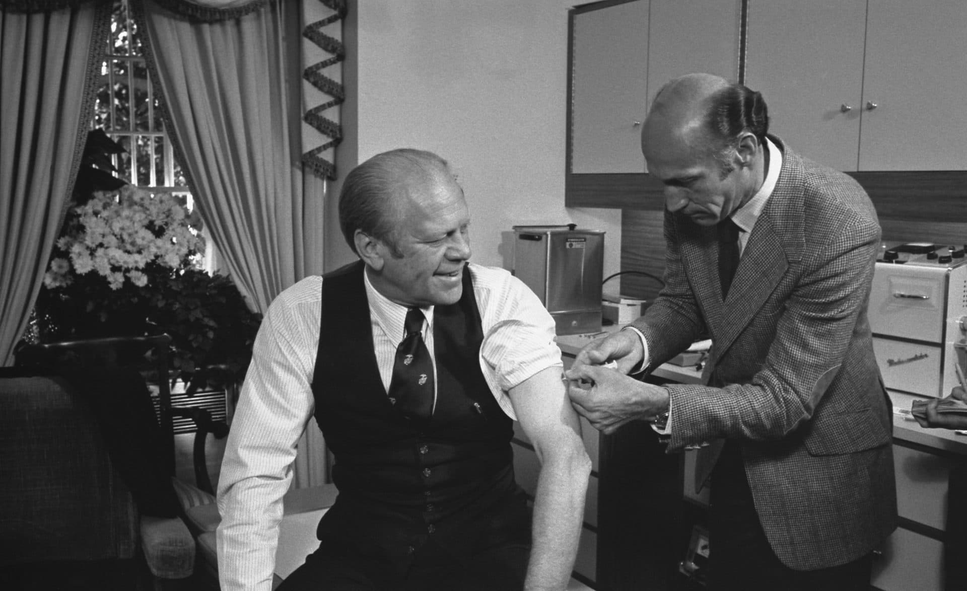President Ford receives a swine flu inoculation from his White House physician, Dr. William Lukash, on October 14, 1976. (Gerald R. Ford Library)
