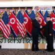 Donald Trump and Kim Jong Un shake hands