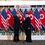 Donald Trump and Kim Jong Un shake hands