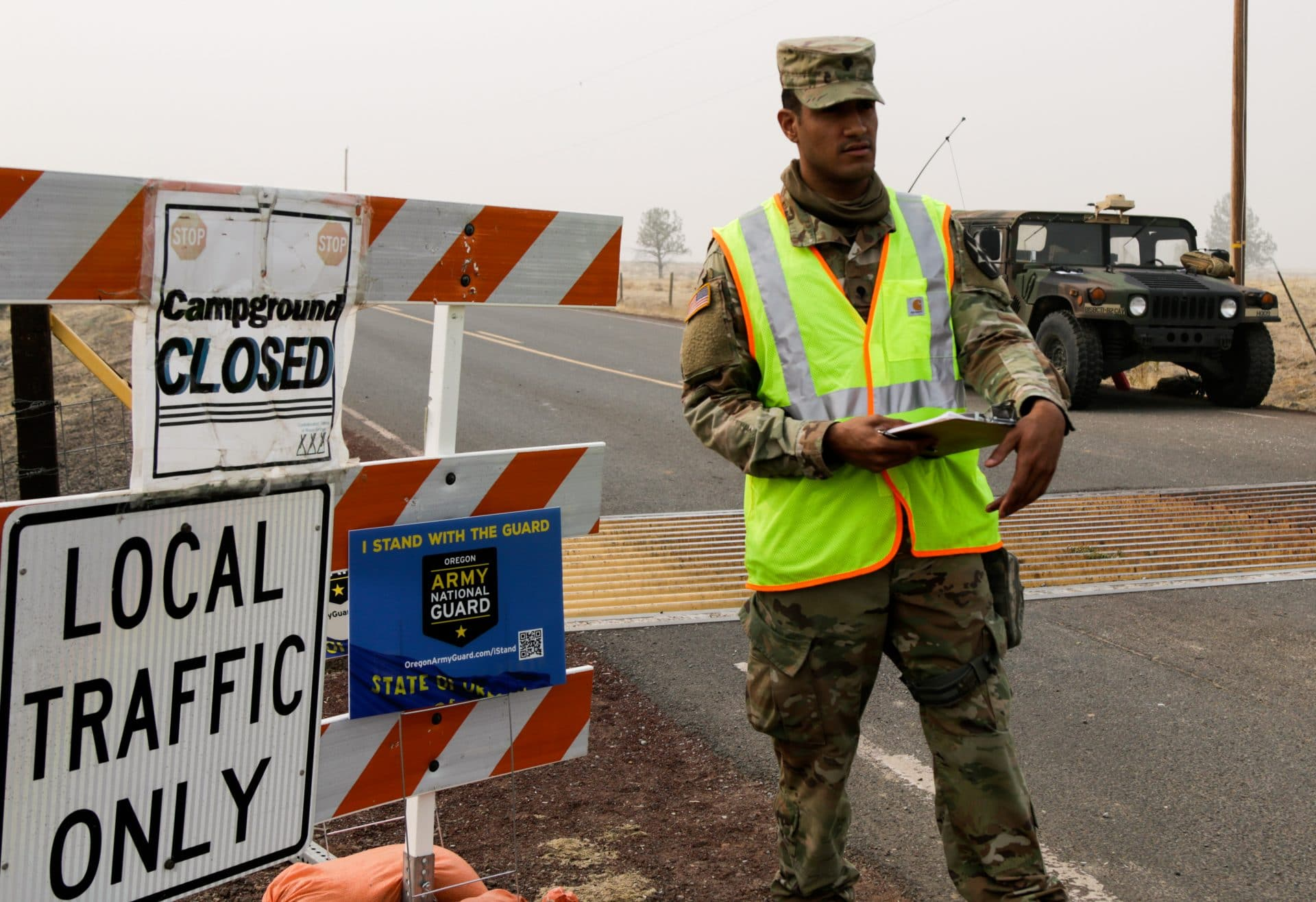 National Guard monitors traffic control point during potential wildfire evacuation