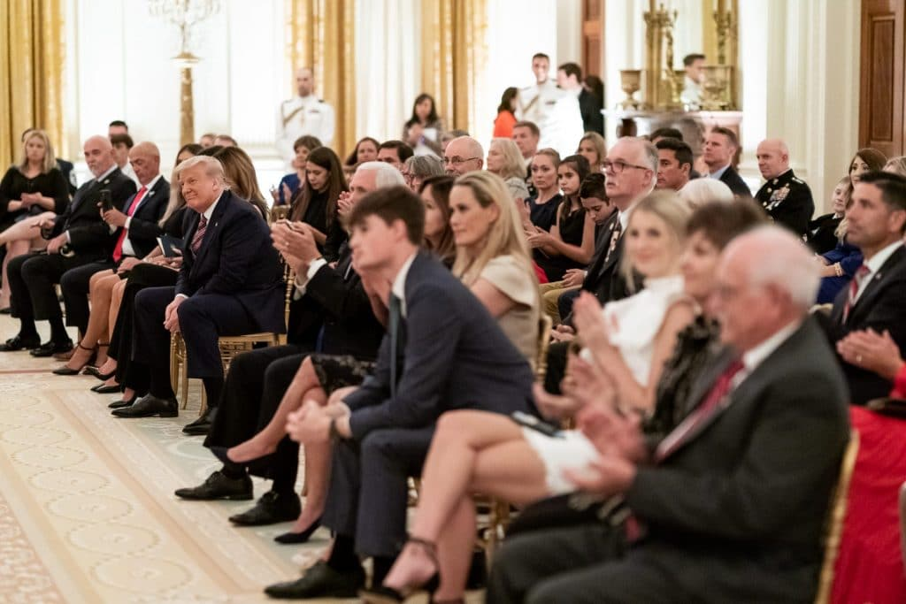President Trump listens as songs are sung during a reception to honor Gold Star Families on September 27 in the East Room of the White House.